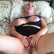 Stepmom spreads pussy for your entertainment