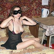 Stunning horny slut putting on a show for you in negligee face mask