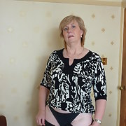 Sexy milf Karen stripping off her clothes after work getting naked