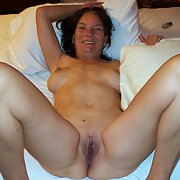 Kathy poses showing off her hot milf ass ad caressing her ample bosum