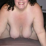 My BBW in red on the bed showing off for you