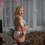 Mature Russian mom posing in front of you