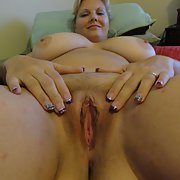 A stunning BI wife posing in and around the house having sum fun
