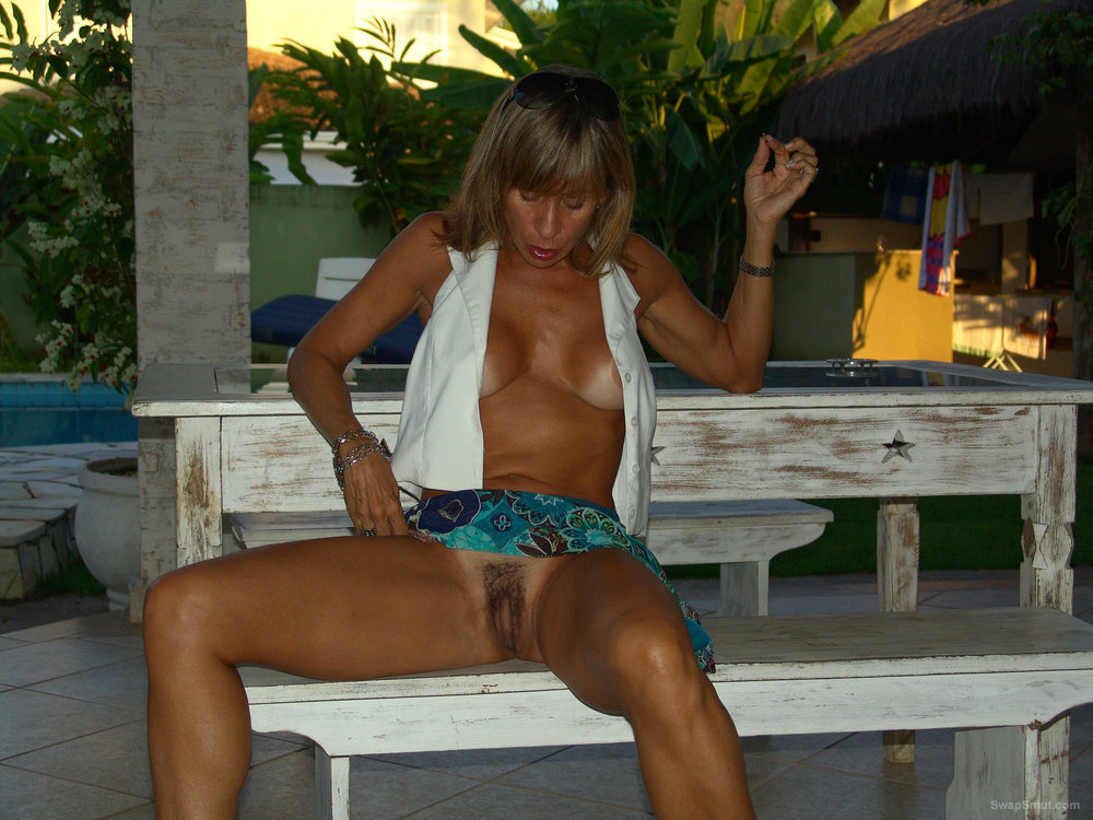 Tanned mature amateur wife revealing large hairy gash and breasts on vacation