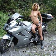 Naughty photos taken in woods on motorbike wearing next to nothing