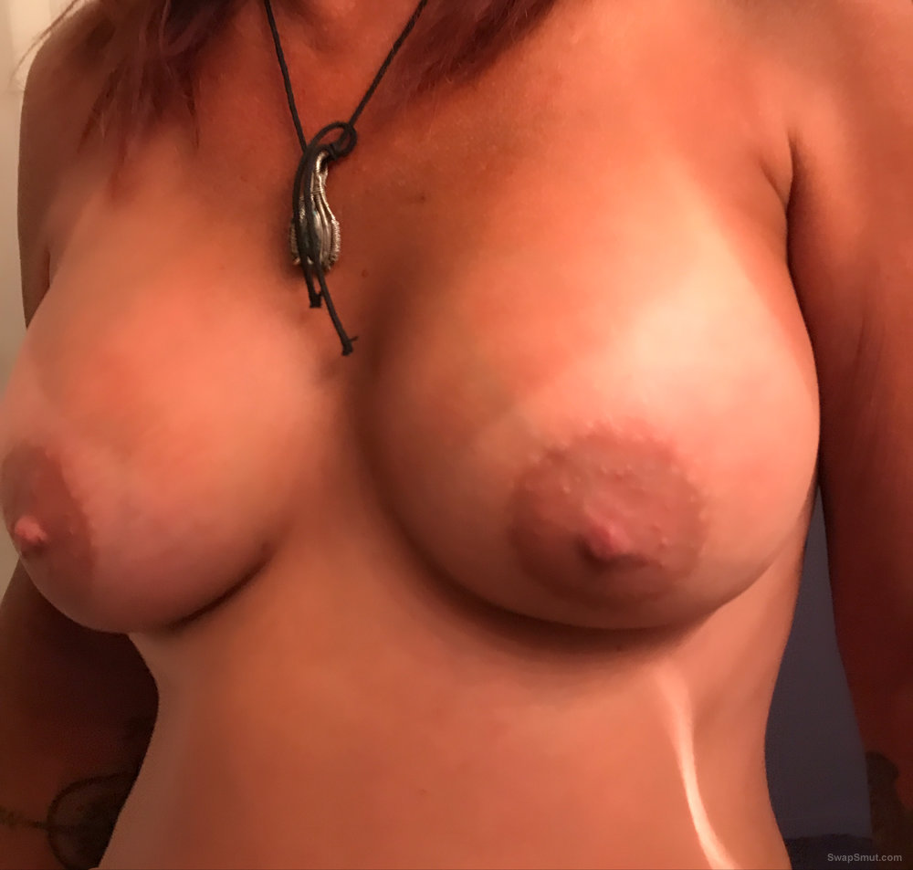 Hot wife relaxing in her chair showing some goodies