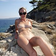 Hot blonde nudist sunbathing at the beach