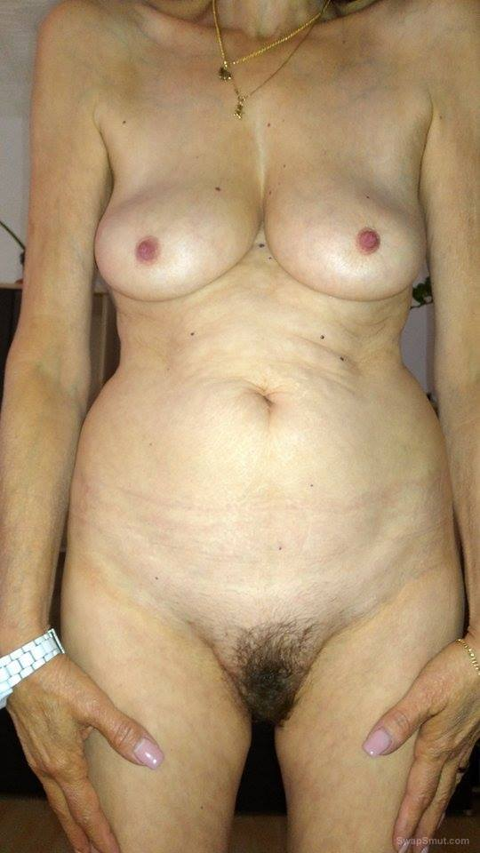 Women nude showing hairy pussy