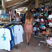 Sexy wife milf walking around in bikini with see through dress shop