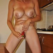 Mature slut in the kitchen doing some cocking