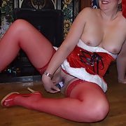 Wife in sexy santa outfit with red stockings