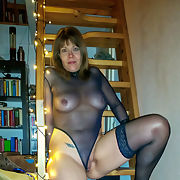 Mature German woman in black lingerie, high heels and flesh-colored stockings