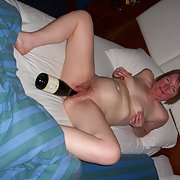 After the champagne she fucks herself with the bottle