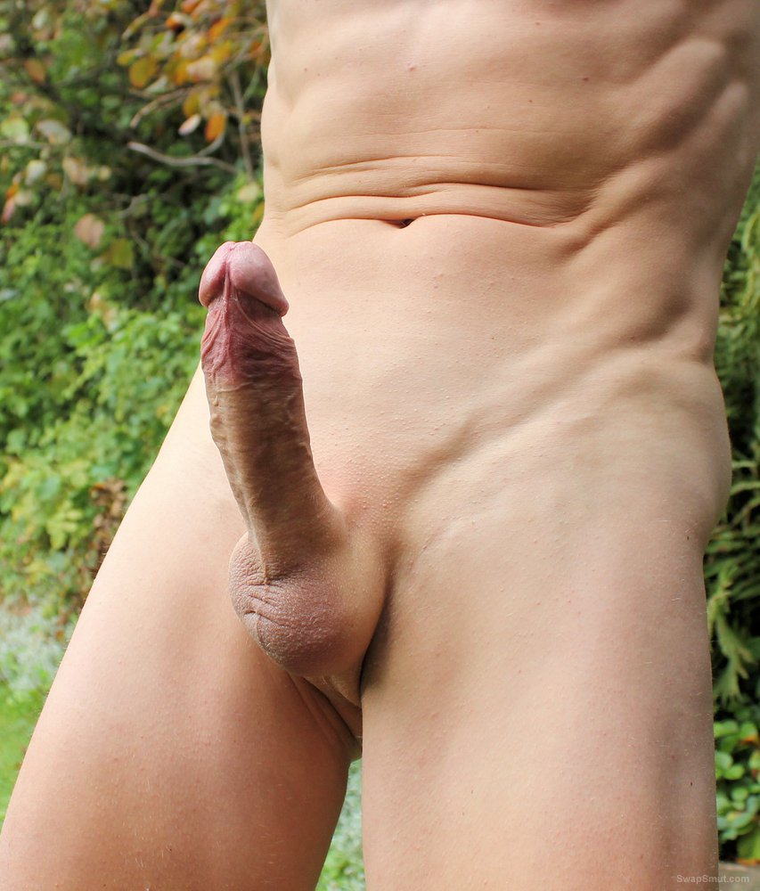 Shaved penis erect and flaccid outside in the garden nude in public