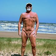 Nude beach guy looking at you as nude as can be