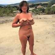 Naked wife on the beach by the lake