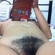 My hairy Filipina wife shows pussy while reading in bedroom