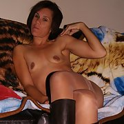 Wearing only stockings and knee high boots sexy milf posing for you