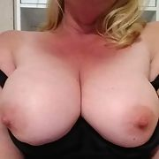 Blonde milf showing her tits for everyone to see