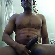 Playing with that thick black bull cock for that pussy