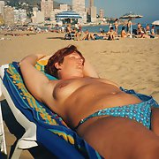Tanning in the back garden and on the beach topless getting nice rays