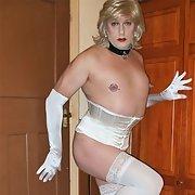 Pierced sissy Rachel in white basque, stockings and heels