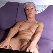 GILF stripping to show my Hairy Pussy on the sofa