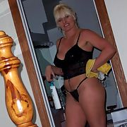 A busty mature slut posing aroung the house