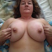 My hot big tittied whore wants your cum on her big tits