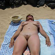 Mature slut enjoying the beach naked of course