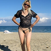 Blondie showing off on sunny beach