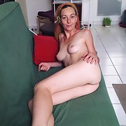 Audrey french milf showing on couch