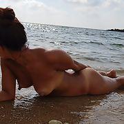Japanese Milf Wife Asahi nude at a public beach