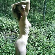 Wife stripping off and going nude outdoors