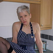 More pics of GILF in the kitchen wearing my new apron