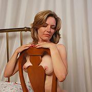 Hottie posing in red in bedroom