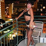 This mature is so sexy in her lovely lingerie posing on a balcony