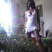 Leggy Ebony Wife Pamela in white dress upskirt pics in high heels