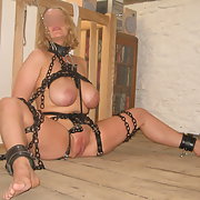 Wearing then not wearing a black dress tied up in bondage gear