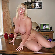 Mature blonde sunning her big tits and naked body