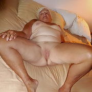 Naked Granny likes to show her body to all.