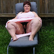 Horny BBW whore loves to show her pussy outdoors in garden