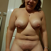 Chunky wife shows her saggy tits and pussy