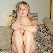 A stunning wife with a hot body and sexy feet looking innocent