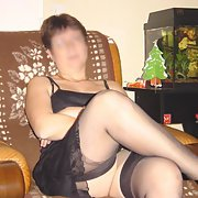 Linda looking hot in her fine black nylons sitting on chair