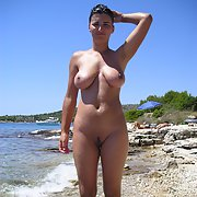 Nude beach and hotel pictures, large Tits