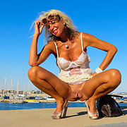 Mature blonde milf exhibitionist photos shot at the marina