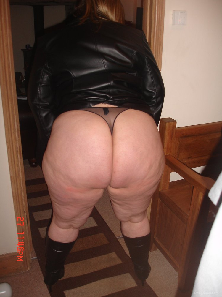 Chubby wife posing in some bdsm gear revealing curvaceous body