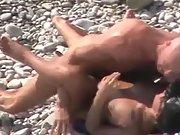 Bald guy fucks his sexy babe on the beach