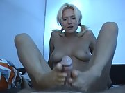 Blonde strips down naked and delivers a perfect footjob POV style